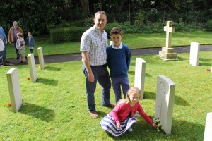 Andy Nuttal and his children at Private (7427) R C Darby's grave.