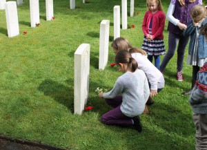 Fovant schoolchildren lay flowers on Private (3662) L Watt's grave.