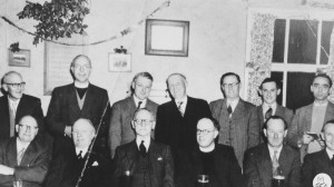 The Home Guard Association Committee in the 1950s, Back row, L to R George Penny, Rev. Eric Blanchette, Willie Langdon, Charlie Foyle, Brigadier W Clapp, Rat Combes, Leslie Bradford. Front Row L  to R Charlie Austin, Brigadier Robert Welchman, Bob Coombes.